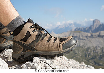 Hiking boots of a hiker in the mountains