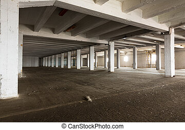 old empty industrial warehouse interior, bright light - an...