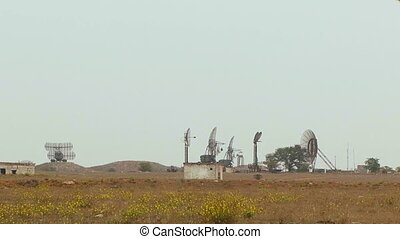 Military radar in a deserted field