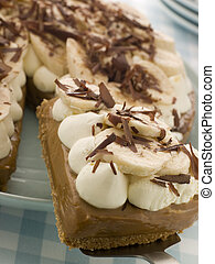 Banoffee Pie With A Slice Being Taken