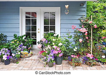 Exterior wall with french door decorated with flowers - Blue...