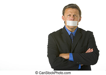 Businessman With His Arms Folded  And His Mouth Taped Shut