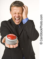 Businessman Holding A Panic Button