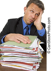 Businessman Overwhelmed By Paperwork