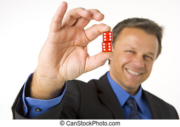 Businessman Holding Two Red Dice
