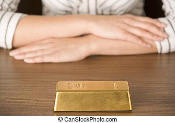 Gold Bar On Desk