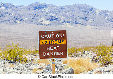 A road sign in Death Valley warning travelers of Caution...