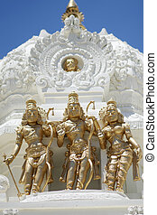 Statues of Brahma, Vishnu and Shiva - Hindu Trimurti: Gold...