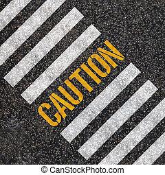 caution concept : paint on asphalt road