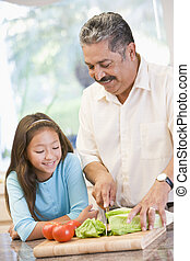 Grandfather And Granddaughter Preparing meal,mealtime...