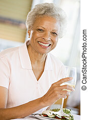 Woman Enjoying meal,mealtime With A Glass Of Wine