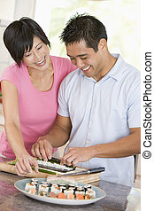Couple Preparing Sushi Together