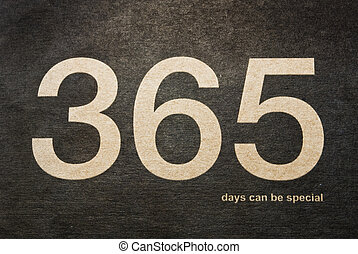 """The golden phrase """"365 days can be special"""" done in cover on a dark paper background."""