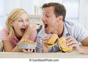 Couple Enjoying Burgers Together