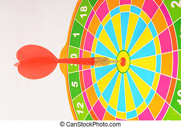 Target aim glossy colored mark with darts in the center