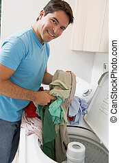 Man Loading Washing Machine