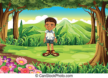 A schoolboy in the middle of the forest