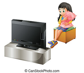 A young girl hugging a pillow while watching TV