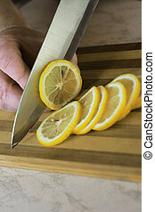 Lemon cut - Cut of lemon on portion by a metallic knife