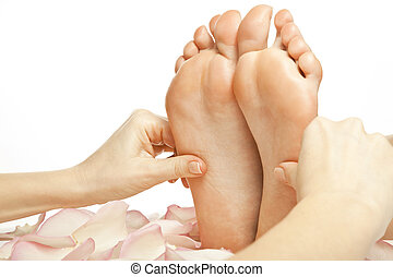 foot massage female legs - woman foot receiving gentle...
