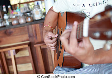 Guitarist plays guitar in cafe