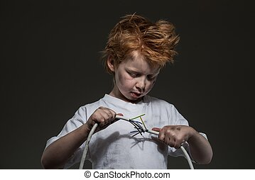 Little redhead bad boy with wires