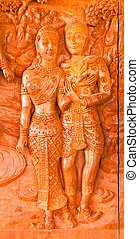 Traditional Thai style wood carving on the door of church,Generality in Thailand, any kind of art decorated in Buddhist church. created with money donated by people, no restrict in copy or use