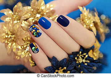 Blue lacquer. - Nails of women covered in blue lacquer...