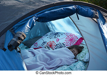 Child Camping  - A girl sleep in camping tent overnight.