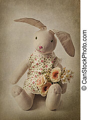 Hare toy on a brown background