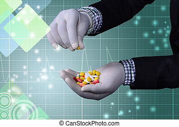 Different pills on the hand of doct