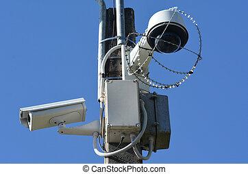 Security surveillance cameras - Two security surveillance...
