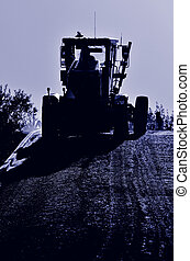 Road grader - Silhouette of a Grader working at road...