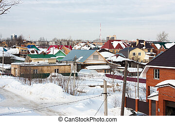 the winter rural landscape is in a private sector, Russia