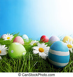 Easter Greeting Card with decorated eggs in the grass and...