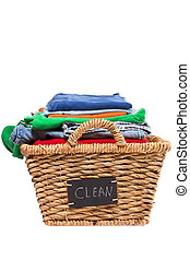 Wicker laundry basket filled with clean clothes - Wicker...