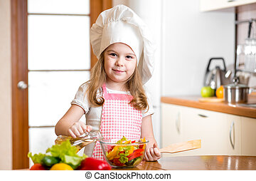 child girl cooking at kitchen