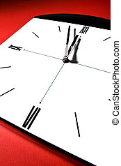 Clock - Wide angle shot of a clock on red background