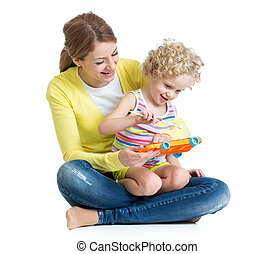 Mother and child play musical toy isolated on white background