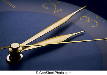 Clock - Macro shot of a clock showing the minutes and...