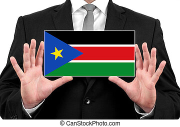 Businessman holding a business card with South Sudan Flag