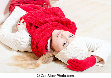 pretty happy woman wearing red knitted scarf and gloves -...