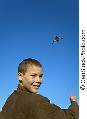 Boy flying a kite close face - Boy flying a kite with clear...