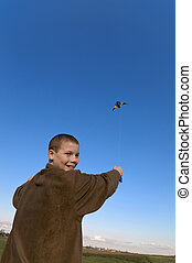 Boy flying a kite face slant - Boy flying a kite with clear...