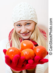 Girl holding juicy oranges - Portrait of a beautiful blonde...