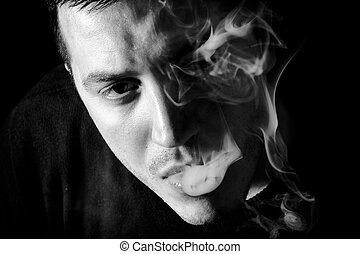 Smoking man - Portrait of man with smoke,low key and black...