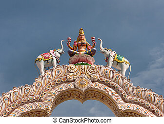 Goddess Lakshmi on top of the entrance gate at Sripuram -...