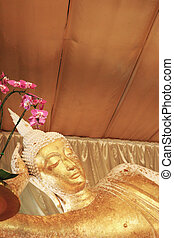Reclining Buddha gold statue face,Thailand