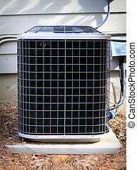 Air conditioner condenser next to a house