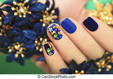 Blue lacquer - Nails of women covered in blue lacquer...